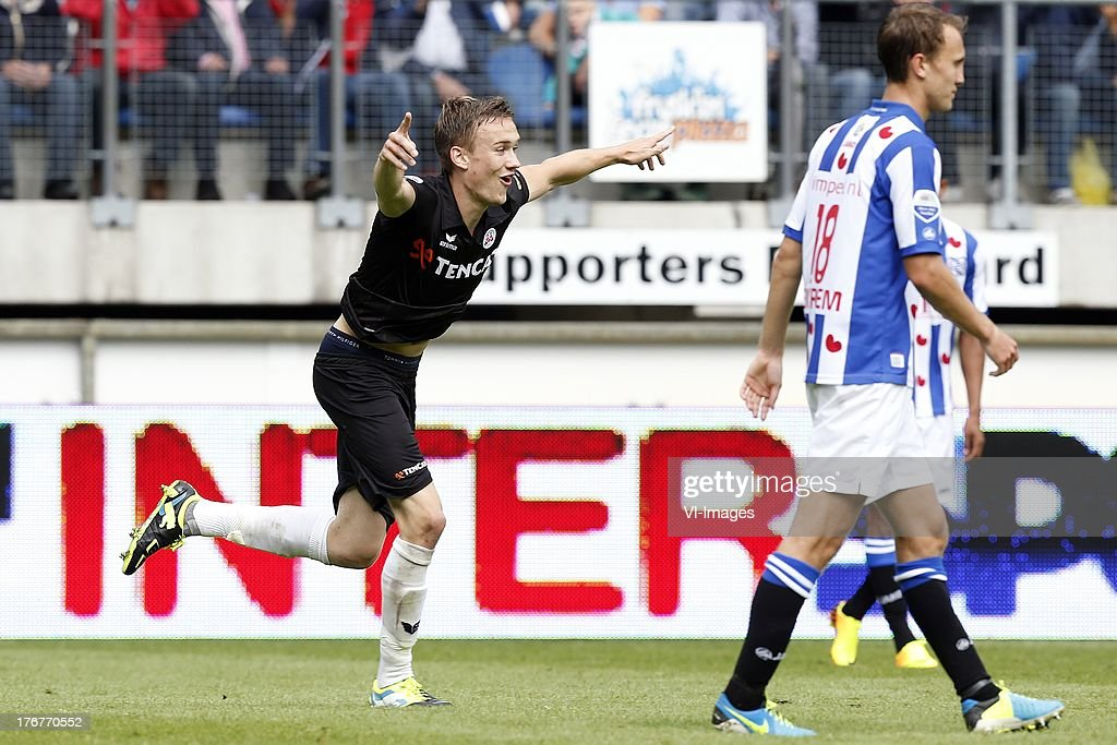 Mike te Wierik of Heracles Almelo (L), Magnus Eikrem of SC Heerenveen (R) during the Dutch Eredivisie match between sc Heerenveen and Heracles Almelo on August 18, 2013 at the Abe Lenstra stadium in Heerenveen, The Netherlands.