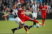 Mike te Wierik of Heracles tackles Jesus Corona of Twente during the Dutch Eredivisie match between Heracles Almelo and FC Twente at Polman Stadion...