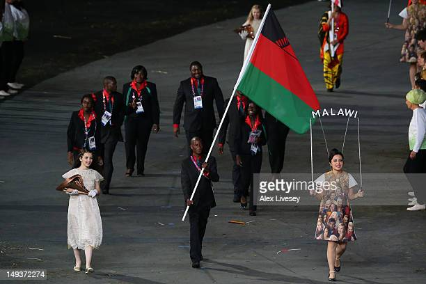 Mike Tebulo of the Malawi Olympic athletics team carries his country's flag during the Opening Ceremony of the London 2012 Olympic Games at the...