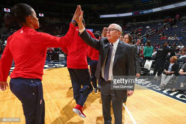 Mike Thibault of the Washington Mystics high fives a player before the game against the Chicago Sky on May 26 2017 at the Verizon Center in...