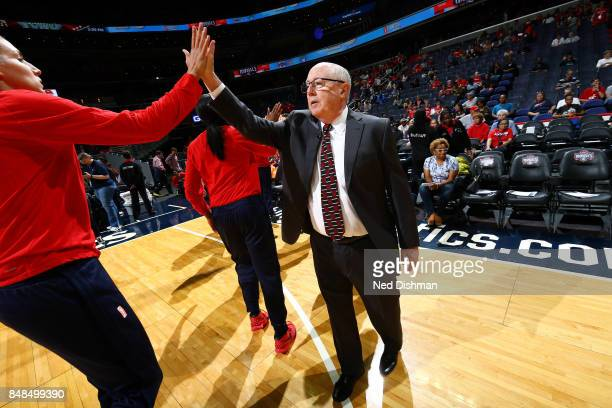 Mike Thibault of the Washington Mystics high fives Elena Delle Donne of the Washington Mystics before the game against the Minnesota Lynx in Game...