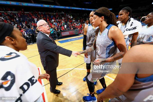 Mike Thibault of the Washington Mystics shakes hands with Seimone Augustus and Maya Moore of the Minnesota Lynx after the game in Game Three of the...