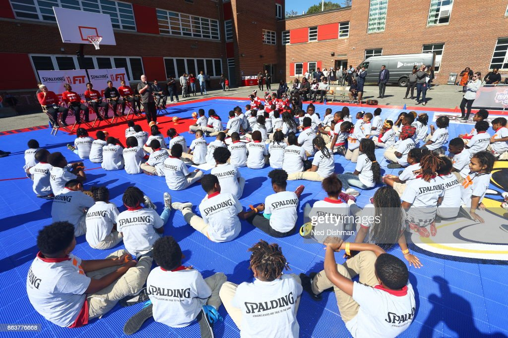 Mike Thibault of the Washington Mystics speaks with kids from Hendley Elementary school during a court dedication and Fit Clinic on October 17, 2017 at Hendley Elementary school in Washington, DC.