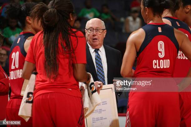 Mike Thibault of the Washington Mystics talks with his team during the game against the Atlanta Dream on July 19 2017 at the Verizon Center in...