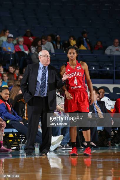 Mike Thibault talks with Tayler Hill of the Washington Mystics during the game against the Chicago Sky goes to the basket against the Washington...