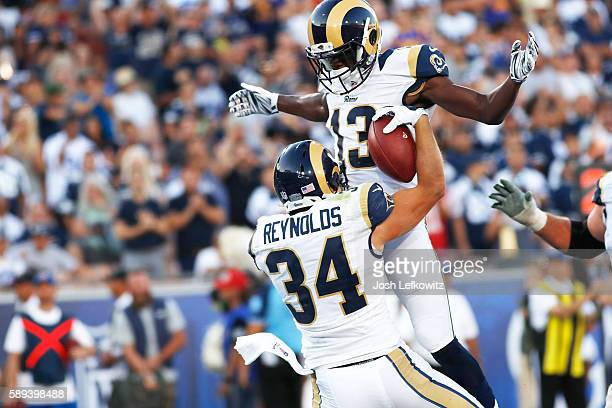 Mike Thomas congradulates Chase Reynolds of the Los Angeles Rams after scoring a touchdown at the Los Angeles Memorial Coliseum during a preseason...