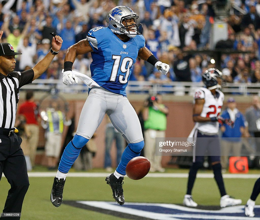 Mike Thomas #19 of the Detroit Lions celebrates a second quarter touchdown while playing the Houston Texans at Ford Field on November 22, 2012 in Detroit, Michigan.