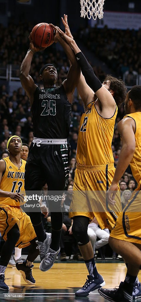 Mike Thomas #25 of the Hawai'I Rainbow Warriors puts up a shot over Ioannis Dimakopoulos #12 of the UC Irvine Anteaters at Stan Sheriff Center on February 12, 2016 in Honolulu, Hawaii.