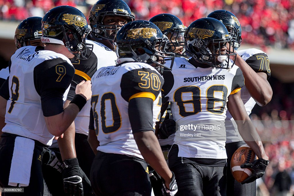 Mike Thomas of the Southern Miss Golden Eagle is congratulated by teammates after catching a pass against the WKU Hilltoppers at HouchensSmith...