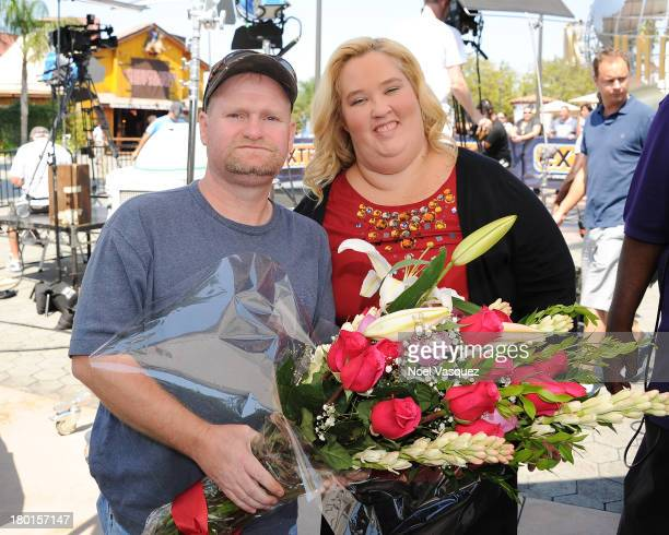 Mike Thompson and June Shannon visit 'Extra' at Universal Studios Hollywood on September 9 2013 in Universal City California