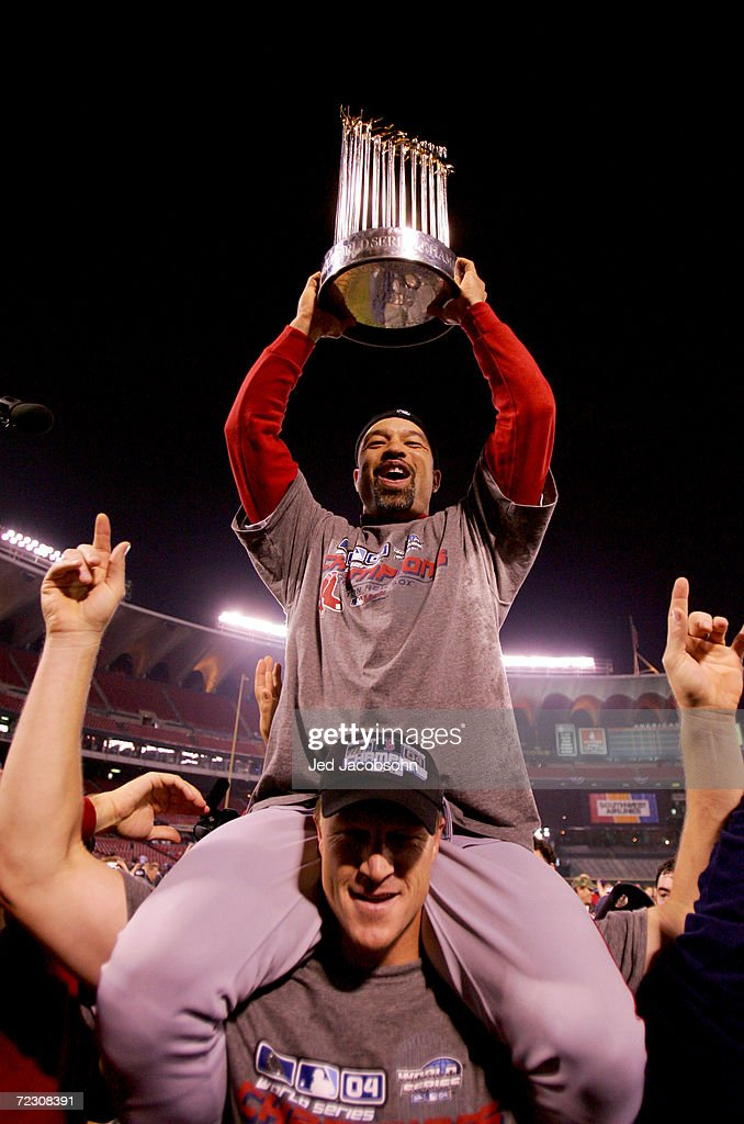 Mike Timlin and Dave Roberts of the Boston Red Sox celebrate on the field with the trophy after defeating the St Louis Cardinals 30 in game four of...