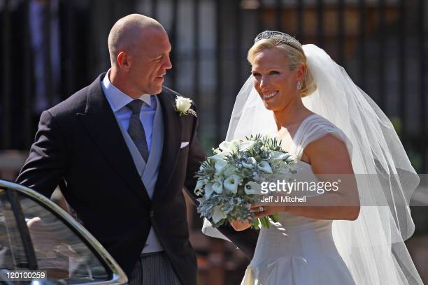 Mike Tindall and Zara Phillips depart after their Royal wedding at Canongate Kirk on July 30 2011 in Edinburgh Scotland The Queen's granddaughter...