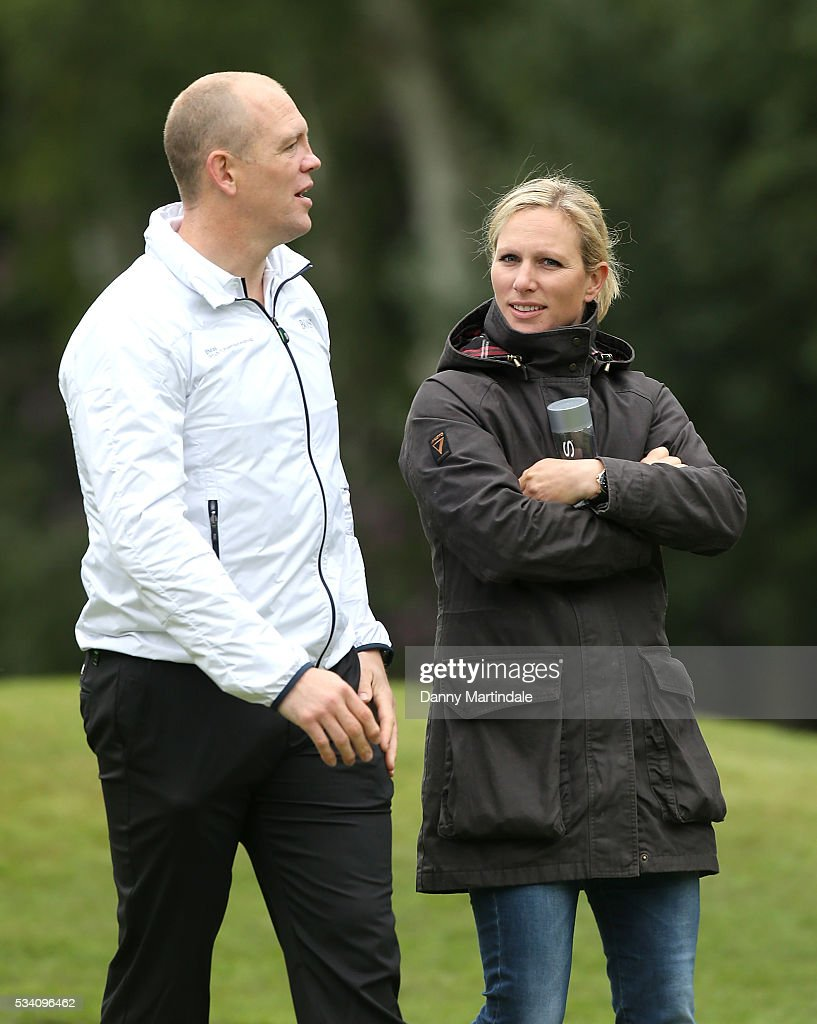 <a gi-track='captionPersonalityLinkClicked' href=/galleries/search?phrase=Mike+Tindall&family=editorial&specificpeople=204210 ng-click='$event.stopPropagation()'>Mike Tindall</a> and <a gi-track='captionPersonalityLinkClicked' href=/galleries/search?phrase=Zara+Phillips&family=editorial&specificpeople=161323 ng-click='$event.stopPropagation()'>Zara Phillips</a> share a moment at the BMW PGA Celebrity Pro-Am Golf Championship at Wentworth on May 25, 2016 in Virginia Water, England.