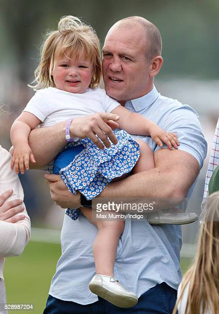 Mike Tindall carries daughter Mia Tindall after watching Zara Tindall compete in the cross country phase of the Badminton Horse Trials on May 7 2016...