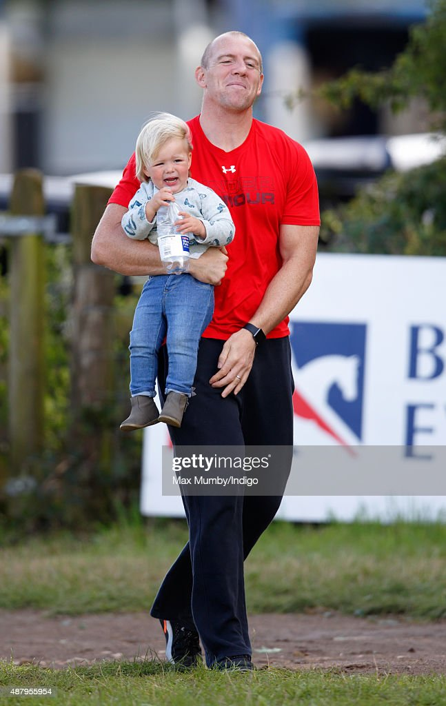 Mike Tindall carries daughter Mia Tindall as they attend day 2 of the Whatley Manor International Horse Trials at Gatcombe Park on September 12, 2015 in Stroud, England.