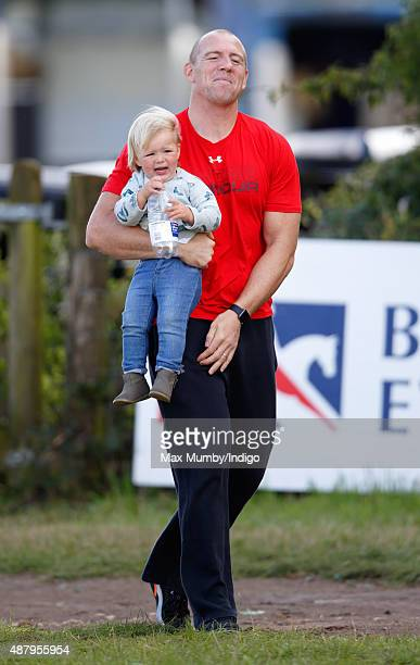 Mike Tindall carries daughter Mia Tindall as they attend day 2 of the Whatley Manor International Horse Trials at Gatcombe Park on September 12 2015...