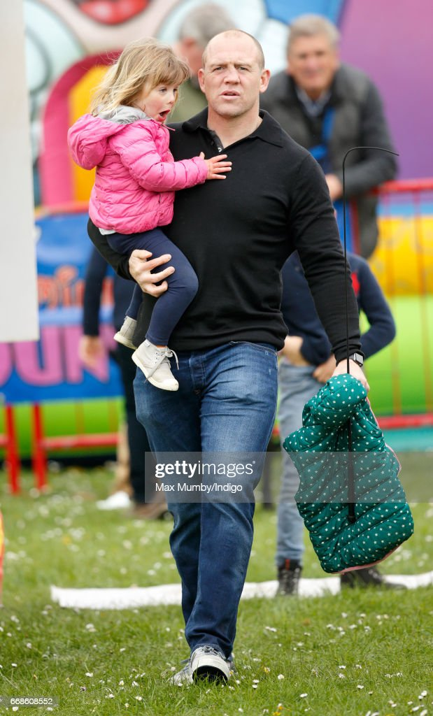 Mike Tindall carries daughter Mia Tindall as they attend the Burnham Market Horse Trials on April 14, 2017 in Burnham Market, England.