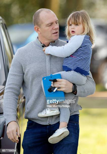 Mike Tindall carries daughter Mia Tindall as they attend the Gatcombe Horse Trials at Gatcombe Park on March 25 2017 in Stroud England