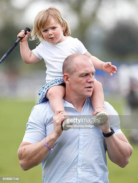 Mike Tindall carries daughter Mia Tindall on his shoulders after watching Zara Tindall compete in the cross country phase of the Badminton Horse...