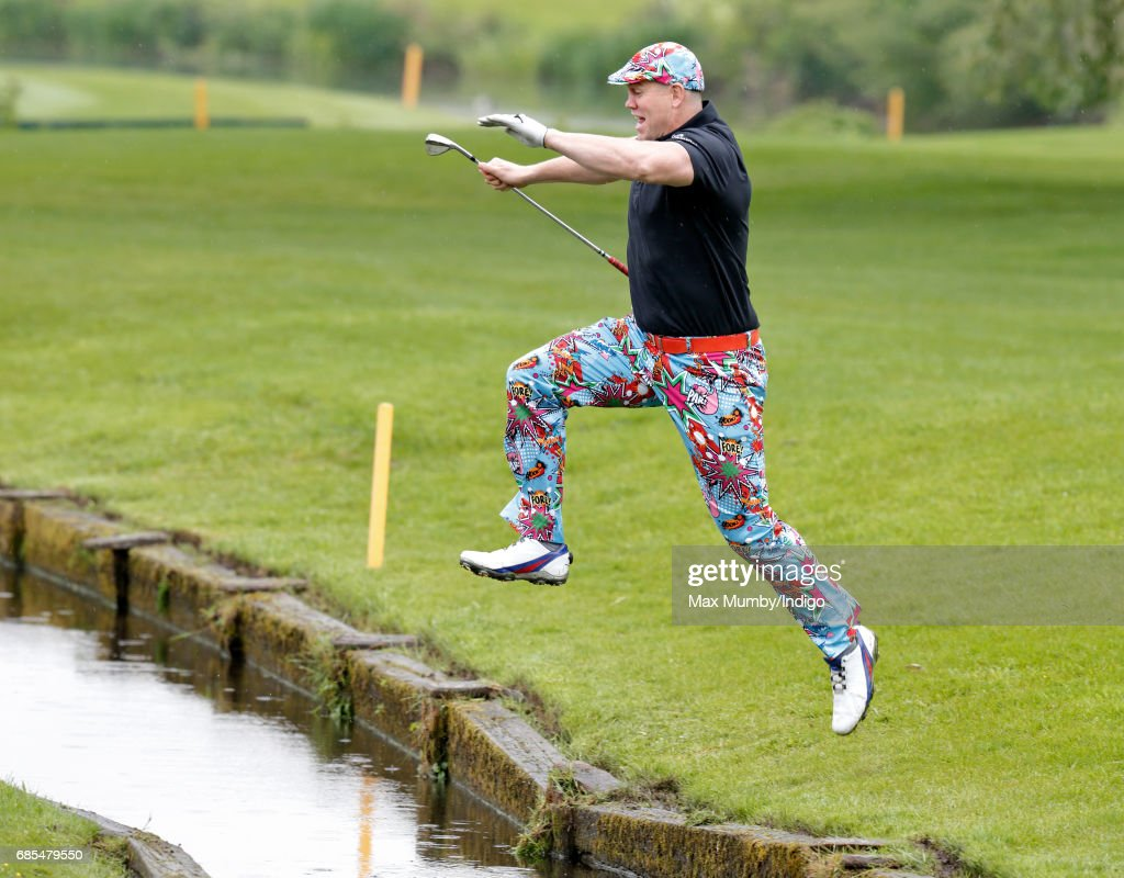 Mike Tindall jumps over a stream as he takes part in the 5th edition of the 'ISPS Handa Mike Tindall Celebrity Golf Classic' at The Belfry on May 19, 2017 in Sutton Coldfield, England.