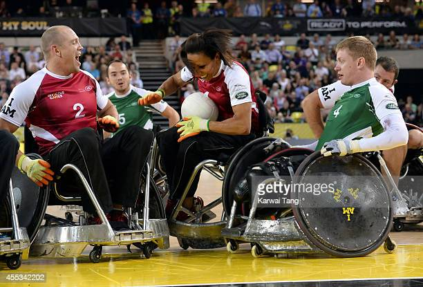 Mike Tindall Kelly Holmes and James Roberts in action today during an exhibition match of wheelchair rugby at the Invictus Games at Copperbox Queen...