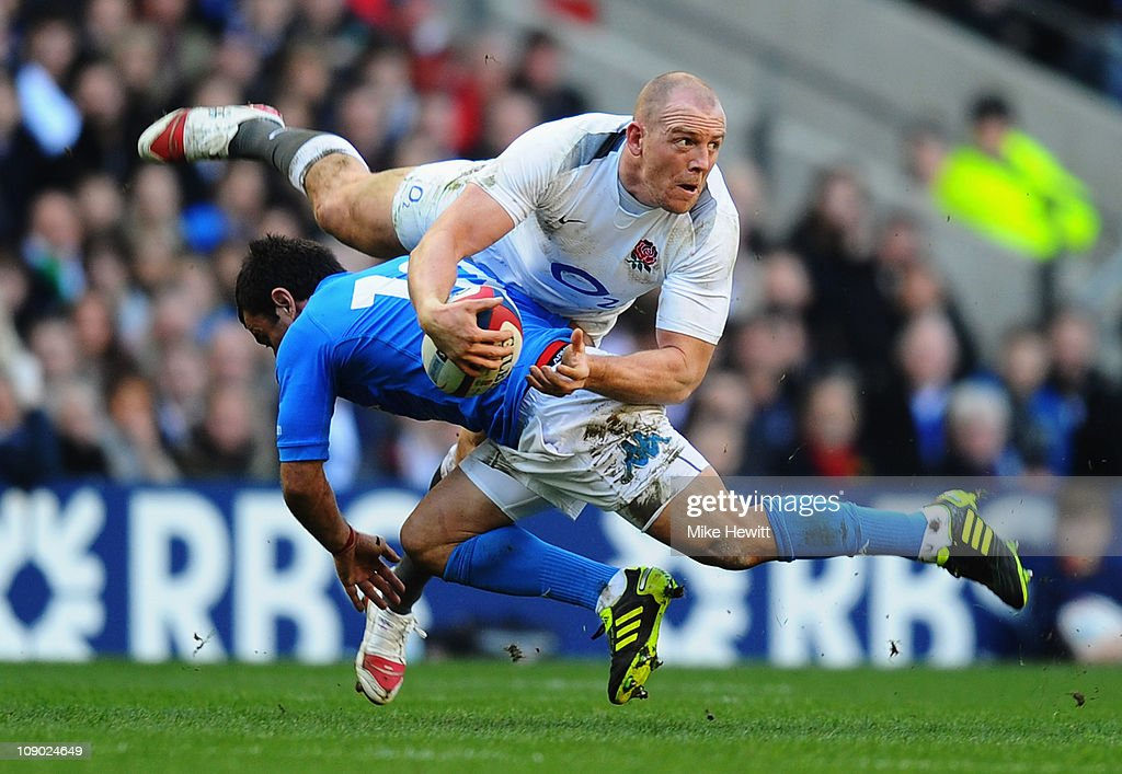 <a gi-track='captionPersonalityLinkClicked' href=/galleries/search?phrase=Mike+Tindall&family=editorial&specificpeople=204210 ng-click='$event.stopPropagation()'>Mike Tindall</a> of England looks to offload as he is tackled by <a gi-track='captionPersonalityLinkClicked' href=/galleries/search?phrase=Luciano+Orquera&family=editorial&specificpeople=236091 ng-click='$event.stopPropagation()'>Luciano Orquera</a> of Italy during the RBS 6 Nations Championship match between England and Italy at Twickenham Stadium on February 12, 2011 in London, England.