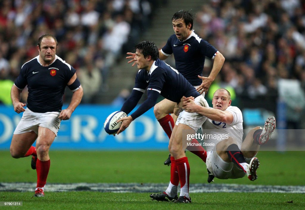 <a gi-track='captionPersonalityLinkClicked' href=/galleries/search?phrase=Mike+Tindall&family=editorial&specificpeople=204210 ng-click='$event.stopPropagation()'>Mike Tindall</a> of England tackles <a gi-track='captionPersonalityLinkClicked' href=/galleries/search?phrase=Francois+Trinh-Duc&family=editorial&specificpeople=4209248 ng-click='$event.stopPropagation()'>Francois Trinh-Duc</a> of France as he tries to offload the ball to <a gi-track='captionPersonalityLinkClicked' href=/galleries/search?phrase=William+Servat&family=editorial&specificpeople=780514 ng-click='$event.stopPropagation()'>William Servat</a> during the RBS Six Nations Championship match between France and England at the Stade de France on March 20, 2010 in Paris, France.