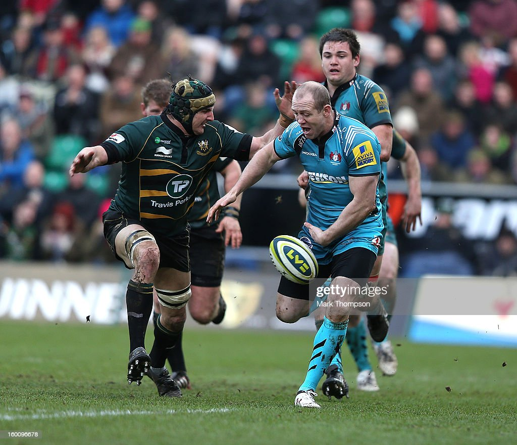 Mike Tindall of Gloucester attempts to control the ball watched by Mark Sorenson of Northampton Saints during the LV=Cup match between Northampton Saints and Gloucester at Franklin's Gardens on January 26, 2013