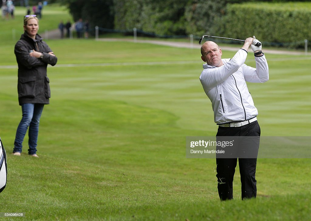 Mike Tindall plays a ball as Zara Phillips watches on at the BMW PGA Celebrity Pro-Am Golf Championship at Wentworth on May 25, 2016 in Virginia Water, England.