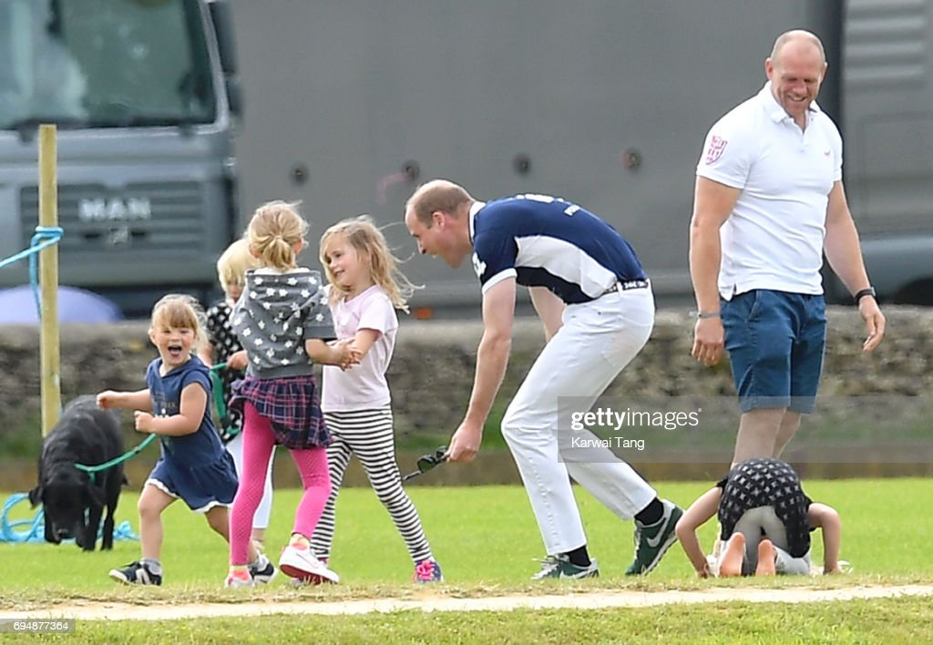 Mike Tindall watches daughter Mia get a hug from Prince William, Duke of Cambridge at the Maserati Royal Charity Polo Trophy at Beaufort Polo Club on June 11, 2017 in Tetbury, England.