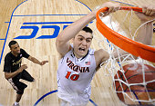 Mike Tobey of the Virginia Cavaliers dunks against the Florida State Seminoles during the quarterfinals of the ACC Basketball Tournament at...