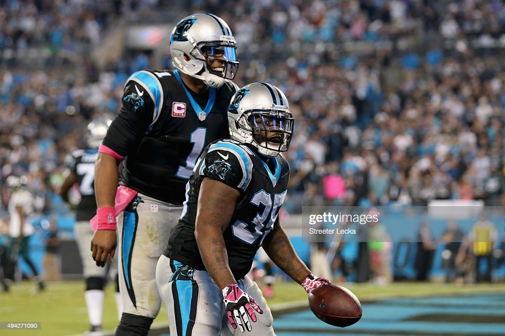 Mike Tolbert and Cam Newton of the Carolina Panthers celebrate a touchdown against the Philadelphia Eagles in the 3rd quarter during their game at...