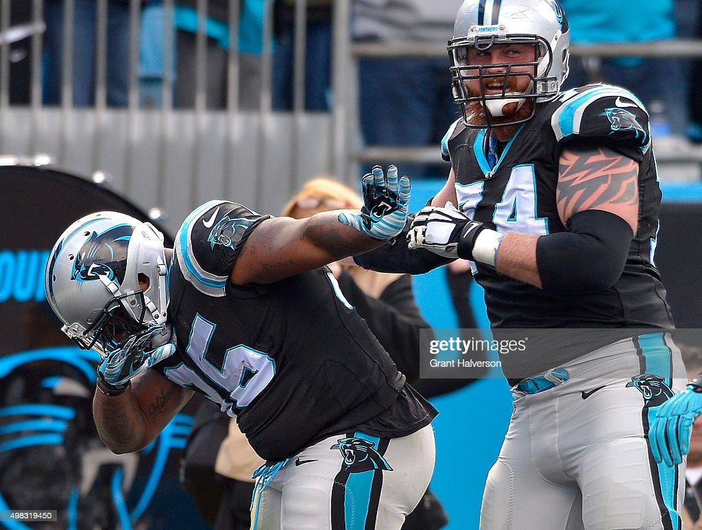 Mike Tolbert and Mike Remmers of the Carolina Panthers celebrate after Tolbert's touchdown against the Washington Redskins during their game at Bank...