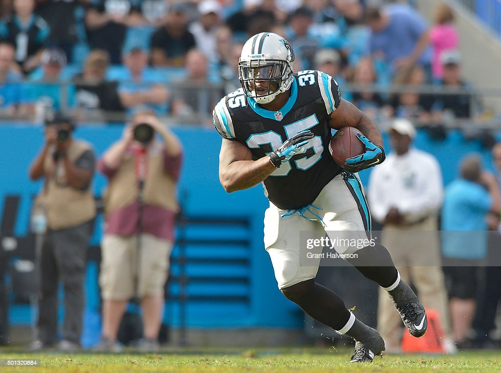 Mike Tolbert of the Carolina Panthers runs against the Atlanta Falcons during their game at Bank of America Stadium on December 13 2015 in Charlotte...