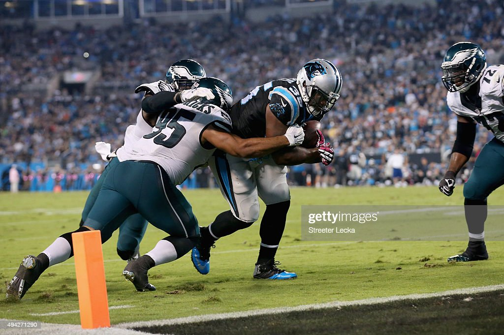 Mike Tolbert of the Carolina Panthers runs the ball against Mychal Kendricks of the Philadelphia Eagles in the 3rd quarter during their game at Bank...