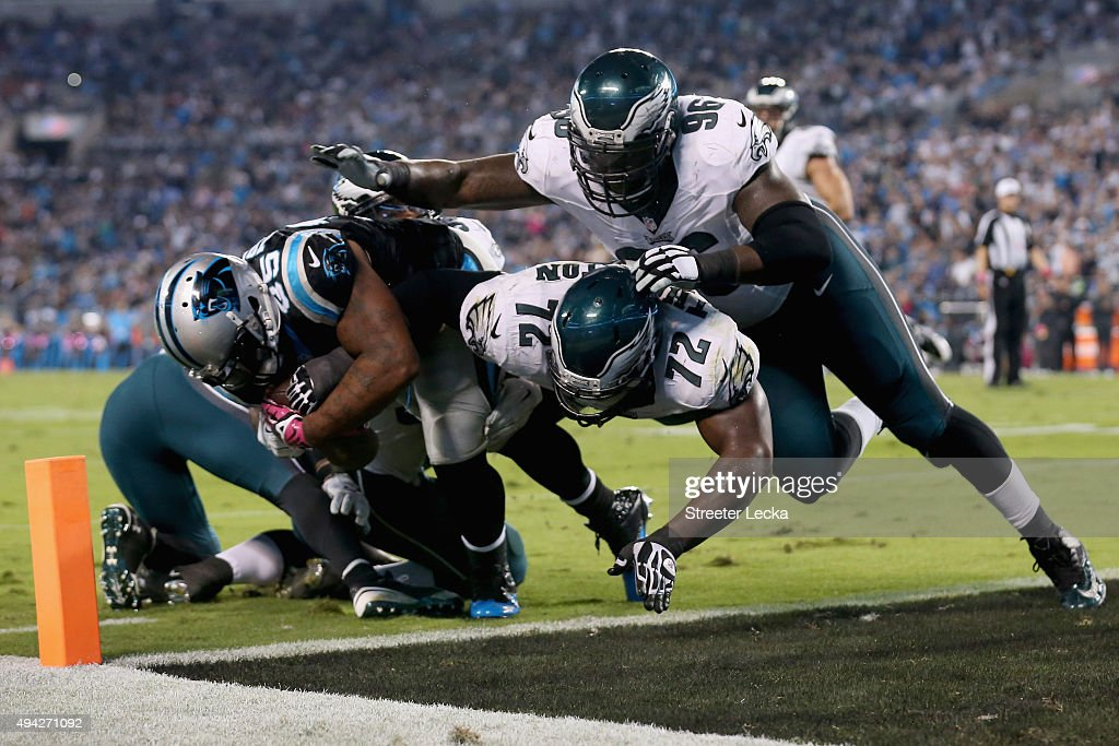 Mike Tolbert of the Carolina Panthers rushes for a touchdown against Cedric Thornton and Bennie Logan of the Philadelphia Eagles in the 3rd quarter...