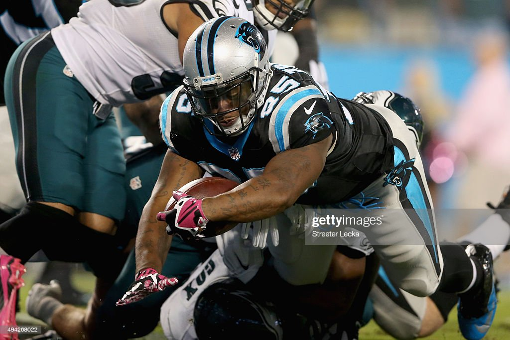 Mike Tolbert of the Carolina Panthers stretches across the goal line against the Philadelphia Eagles in the 1st quarter during their game at Bank of...