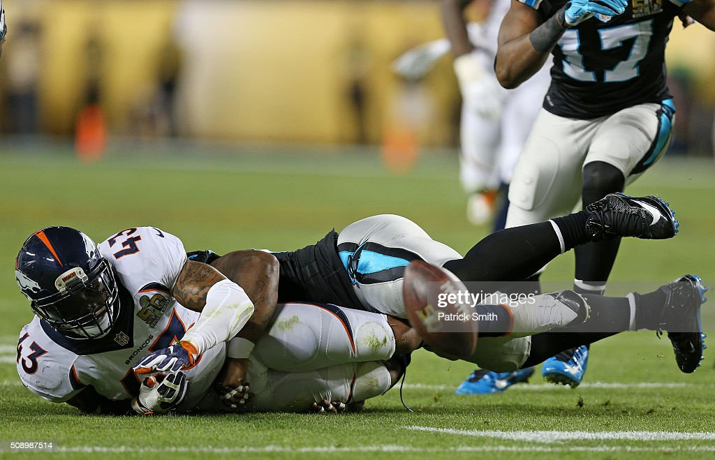 Mike Tolbert of the Carolina Panthers strips the ball from TJ Ward of the Denver Broncos after an interception in the third quarter during Super Bowl...