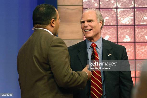 Mike Torico of ABC Sports and ESPN talks to owner of the Cleveland Cavaliers Gordon Gund about winning the overall draft pick during the 2003 NBA...