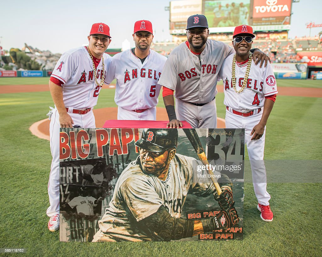 Mike Trout Albert Pujols and infield coach Alfredo Griffin of the Los Angeles Angels of Anaheim pose with David Ortiz second from right #34 of the...