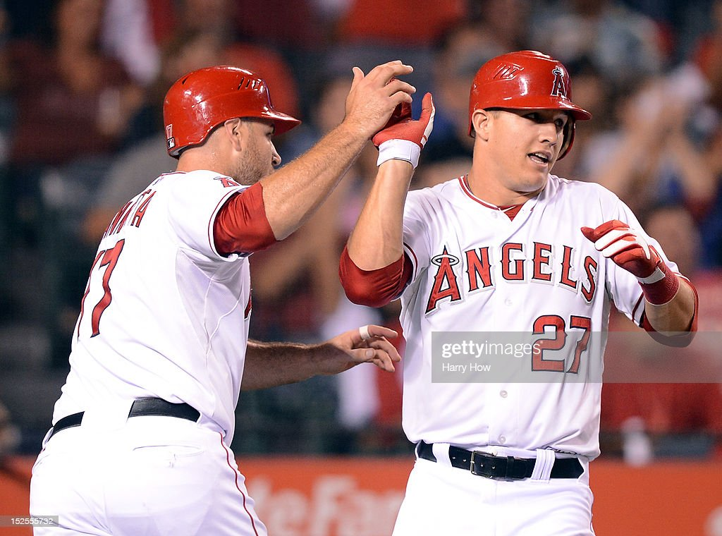 <a gi-track='captionPersonalityLinkClicked' href=/galleries/search?phrase=Mike+Trout&family=editorial&specificpeople=7091306 ng-click='$event.stopPropagation()'>Mike Trout</a> #27 and <a gi-track='captionPersonalityLinkClicked' href=/galleries/search?phrase=Chris+Iannetta&family=editorial&specificpeople=836137 ng-click='$event.stopPropagation()'>Chris Iannetta</a> #17 of the Los Angeles Angels celebrates their runs off of a Albert Pujols #5 singe to take a 3-1 lead over the Chicago White Sox during the third inning at Angel Stadium of Anaheim on September 21, 2012 in Anaheim, California.