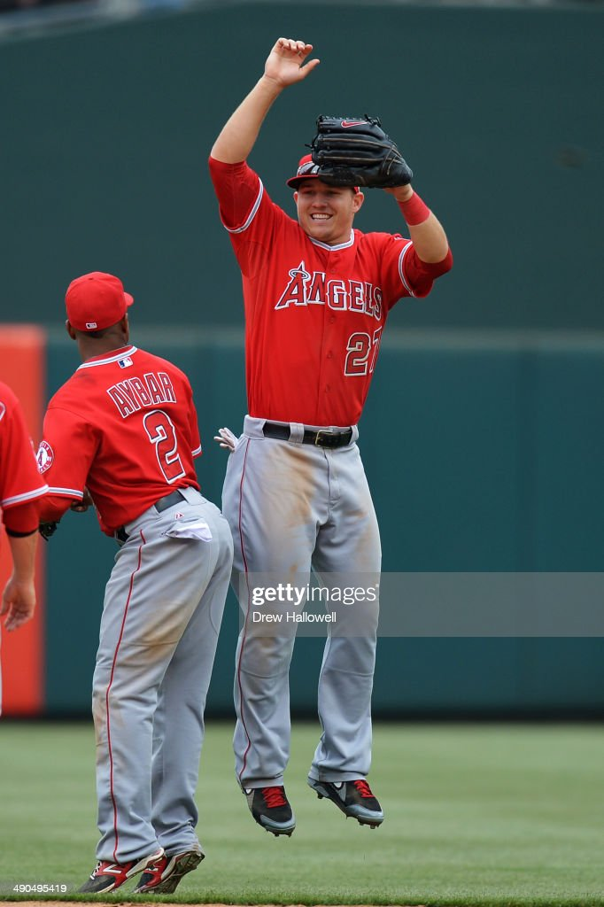 Mike Trout #27 and Erick Aybar #2 of the Los Angeles Angels celebrate a 3-0 win over the Philadelphia Phillies at Citizens Bank Park on May 14, 2014 in Philadelphia, Pennsylvania.