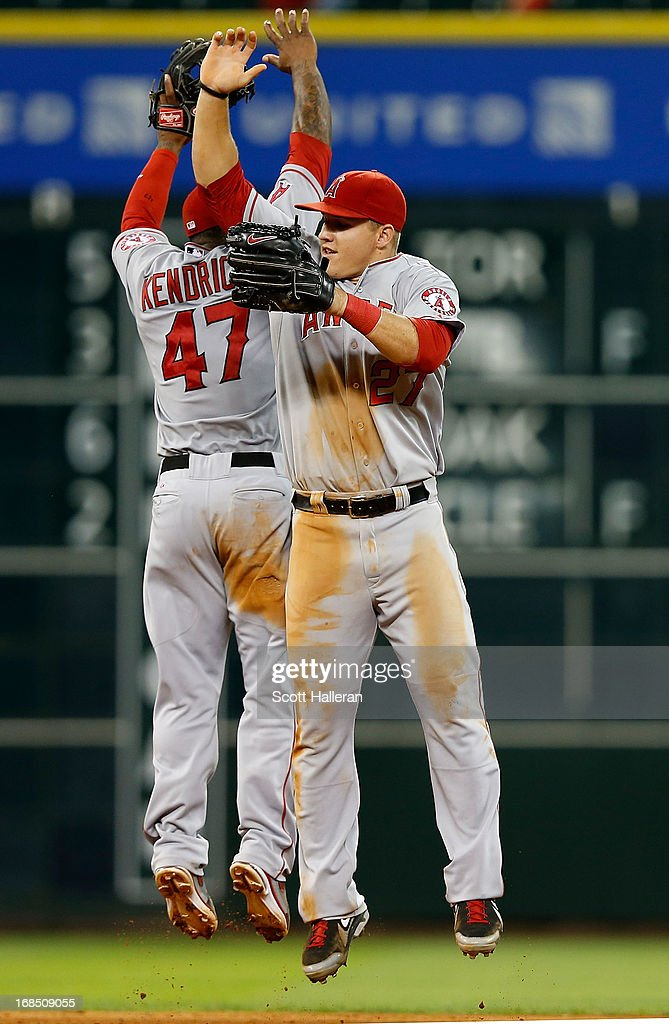 <a gi-track='captionPersonalityLinkClicked' href=/galleries/search?phrase=Mike+Trout&family=editorial&specificpeople=7091306 ng-click='$event.stopPropagation()'>Mike Trout</a> #27 and <a gi-track='captionPersonalityLinkClicked' href=/galleries/search?phrase=Howie+Kendrick&family=editorial&specificpeople=628938 ng-click='$event.stopPropagation()'>Howie Kendrick</a> #47 of the Los Angeles Angels of Anaheim celebrate after defeating the Houston Astros 6-5 at Minute Maid Park on May 9, 2013 in Houston, Texas.