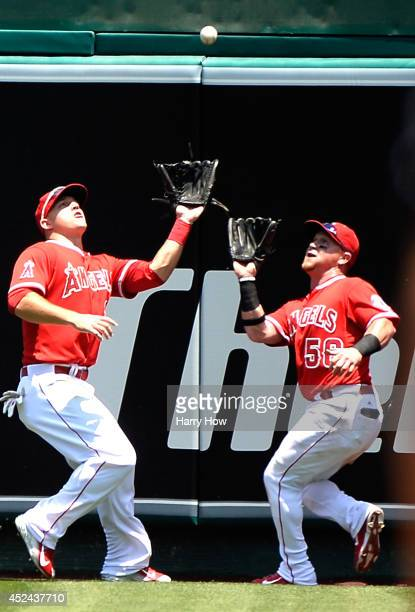 Mike Trout and Kole Calhoun of the Los Angeles Angels converge on a ball hit by Brad Miller of the Seattle Mariners for an out during the second...