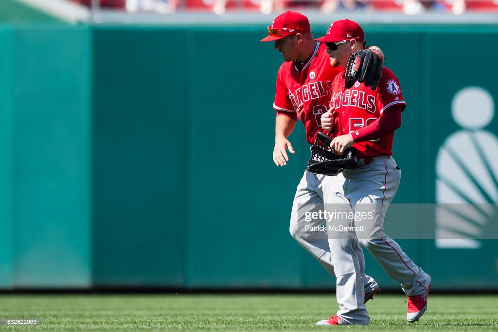 Mike Trout #27 and Kole Calhoun #56 of the Los Angeles Angels of Anaheim celebrate after defeating the Washington Nationals 3-2 at Nationals Park on August 16, 2017 in Washington, DC.