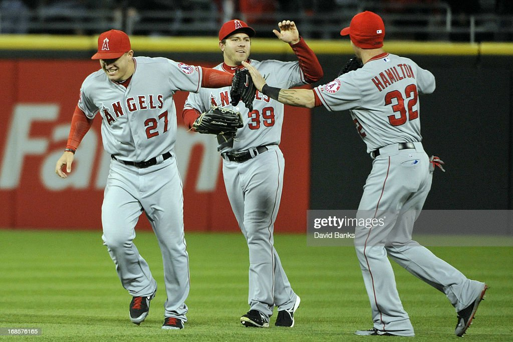<a gi-track='captionPersonalityLinkClicked' href=/galleries/search?phrase=Mike+Trout&family=editorial&specificpeople=7091306 ng-click='$event.stopPropagation()'>Mike Trout</a> #27, J.B. Shuck #39 and Josh Hamilton #32 of the Los Angeles Angels of Anaheim celebrate the Angels win against the Chicago White Sox on May 11, 2013 at U.S. Cellular Field in Chicago, Illinois. The Los Angeles Angels of Anaheim defeated the Chicago White Sox 3-2.