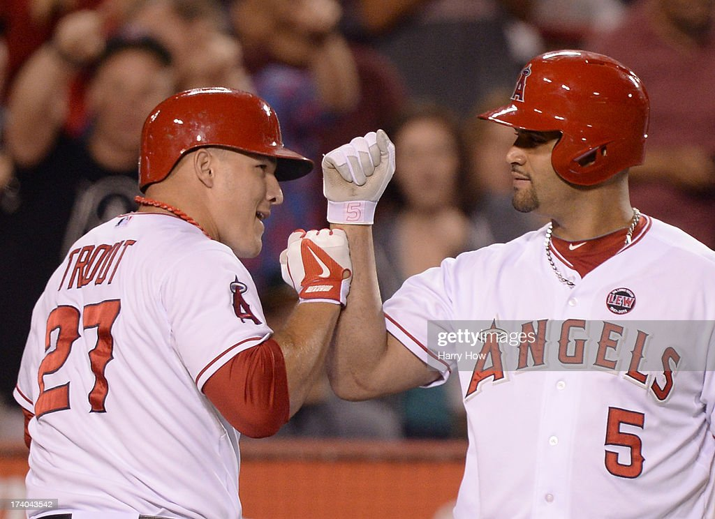 <a gi-track='captionPersonalityLinkClicked' href=/galleries/search?phrase=Mike+Trout&family=editorial&specificpeople=7091306 ng-click='$event.stopPropagation()'>Mike Trout</a> #27 of the Los Angeles Angels celebrates his homerun with <a gi-track='captionPersonalityLinkClicked' href=/galleries/search?phrase=Albert+Pujols&family=editorial&specificpeople=171151 ng-click='$event.stopPropagation()'>Albert Pujols</a> #5 for a 4-0 lead over the Oakland Athletics during the fifth inning at Angel Stadium of Anaheim on July 19, 2013 in Anaheim, California.