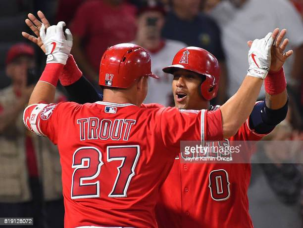Mike Trout of the Los Angeles Angels his met by Yunel Escobar of the Los Angeles Angels after hitting a two run home run in the seventh inning...