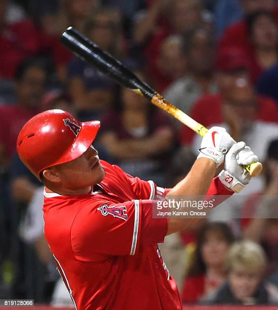 Mike Trout of the Los Angeles Angels hits a two run home run in the seventh inning against the Washington Nationals at Angel Stadium of Anaheim on...