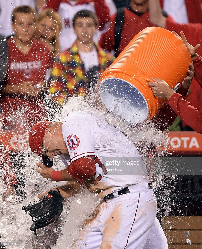 <a gi-track='captionPersonalityLinkClicked' href=/galleries/search?phrase=Mike+Trout&family=editorial&specificpeople=7091306 ng-click='$event.stopPropagation()'>Mike Trout</a> #27 of the Los Angeles Angels is doused with water in celebration of hitting for the cycle after a 12-0 win over the Seattle Mariners at Angel Stadium of Anaheim on May 21, 2013 in Anaheim, California.